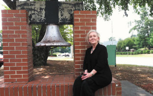 The Dunwoody Woman's Club facilitates preservation of Dunwoody's local history, including display of the original school bell, now located outside the North Dekalb Cultural Center.